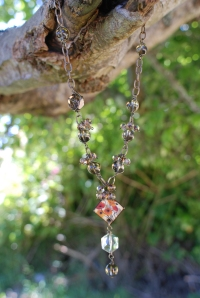 Center Poppy tile by JLynn Jewels, crystal, smokey quartz, and chain.